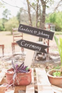 Chalk sign for intimate backyard wedding ceremony in Central Florida