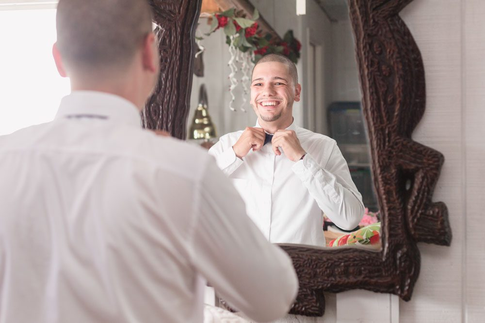 Groom getting ready on the wedding day captured by top Orlando wedding photographer in Kissimmee, Florida