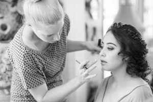 Black and white image of Bride getting ready for her backyard wedding in Kissimmee Florida