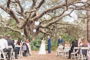 Beautiful wedding ceremony under a tree during a romantic backyard wedding captured by top Orlando photographer