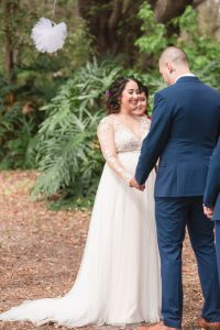Photo from an emotional wedding ceremony outdoors under a tree in Kissimmee Florida