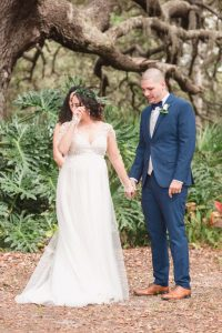 Bride has an emotional reaction during a beautiful outdoor wedding ceremony captured by top Orlando wedding photographer