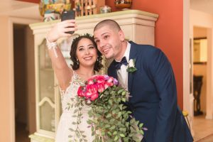 Fun wedding photo of the newlyweds taking a selfie after their wedding day in Central Florida captured by top Orlando wedding photographer and videographer