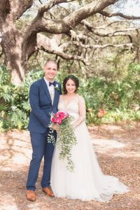Portrait of the bride and groom under a tree after their outdoor backyard wedding ceremony in Kissimmee, Florida south of Orlando