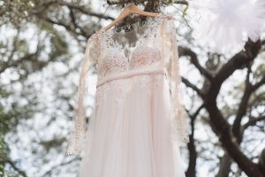 Lace wedding dress with sleeves from Orlando dress shop for intimate Kissimmee wedding day