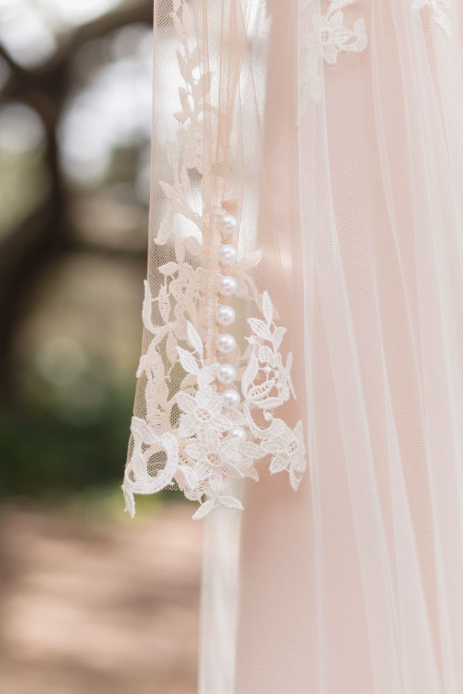 Detail on the sleeve of this wedding dress for an intimate backyard wedding in Kissimmee Florida captured by top Orlando wedding photographer