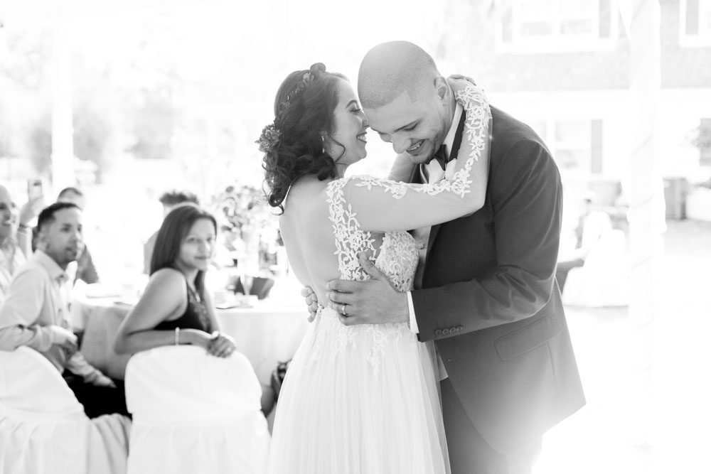 Bride and groom share their first dance during their intimate outdoor wedding reception in Kissimmee captured by Orlando photographer