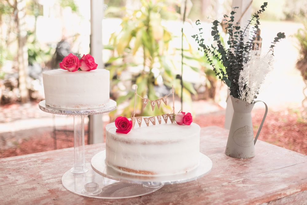 Unique rustic two tier cake with buttercream icing for a boho chic outdooor wedding in Central Florida