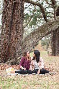 Romantic surprise marriage proposal at a park in downtown Orlando captured by top engagement photographer in Orlando, Florida