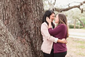 Beautiful engagement portrait under the sprawling trees of Lake Lawsona captured by same-sex engagement photographer in Orlando