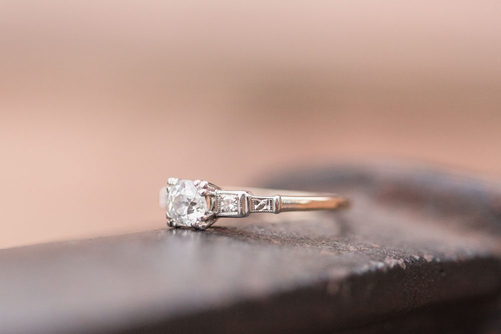Close up of vintage style engagement ring during an engagement photography session in Orlando, Florida