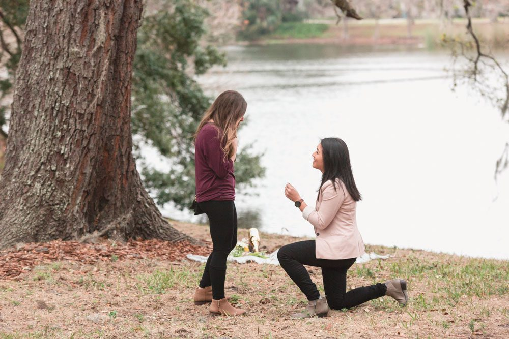 Photography of a surprise proposal by the lake at a park captured by top Orlando lgbt same-sex photographer