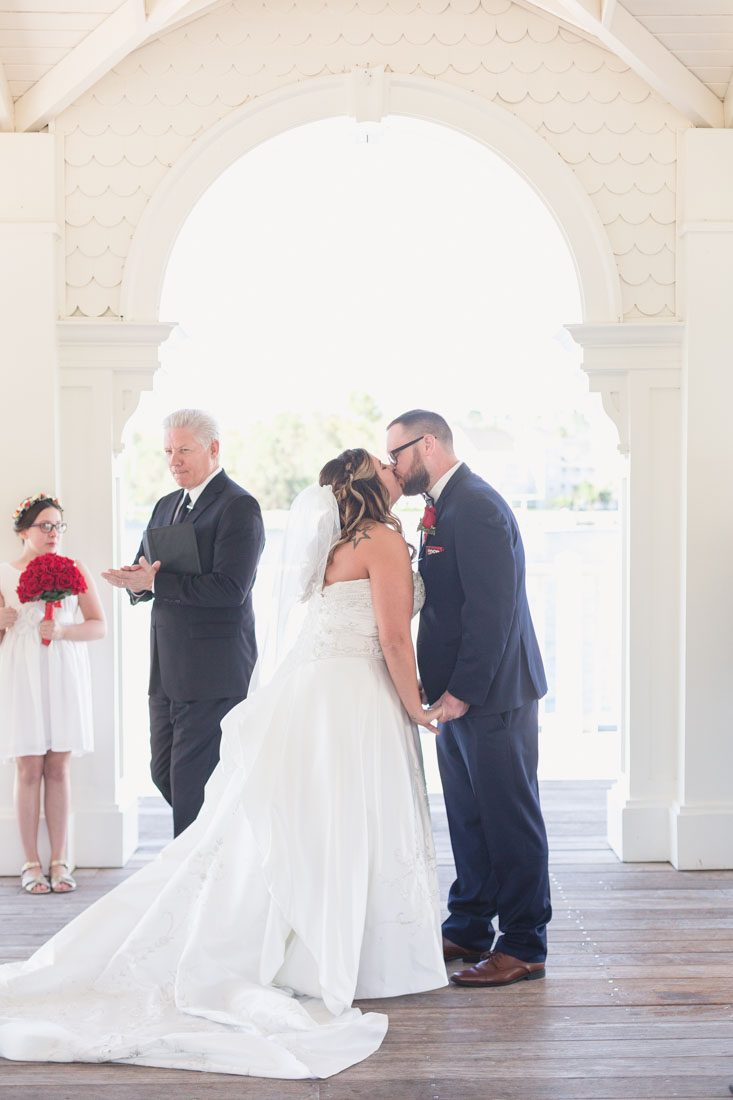 Couple shares their first kiss during their Disney wedding by top photographer in Orlando