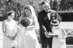 The couples children sign their marriage license during their Disney wedding in Orlando, Florida