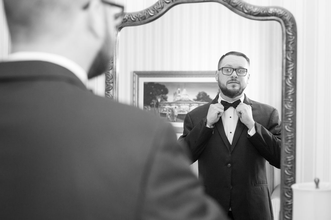 Groom getting ready at the Disney Yacht Club for his wedding ceremony at Sea Breeze Point in Orlando