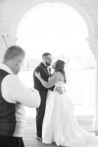 First dance featuring a violinist at Sea Breeze point at the Boardwalk Inn captured by top Orlando wedding photographer