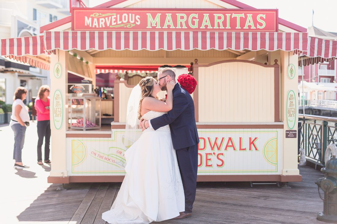 Fun and playful wedding photography in Orlando at the Boardwalk Inn during an intimate Disney wedding