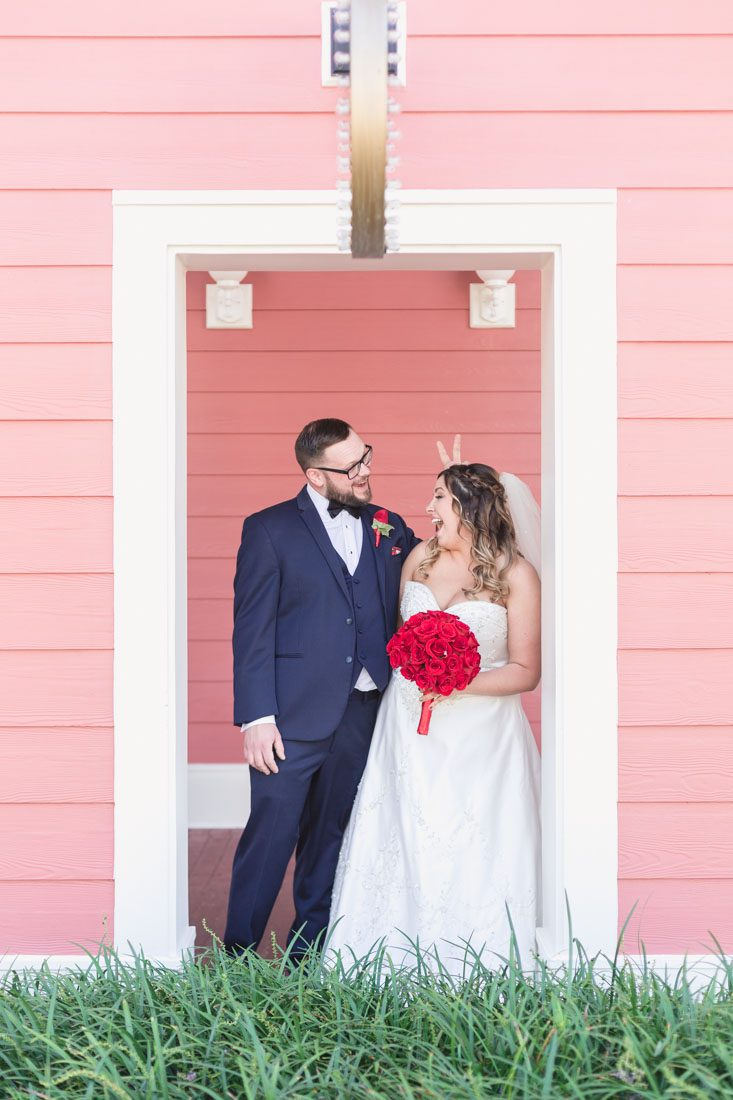 Orlando wedding photographer captures fun and romantic photos of the bride and groom during their Disney wedding day at the Boardwalk Inn Resort