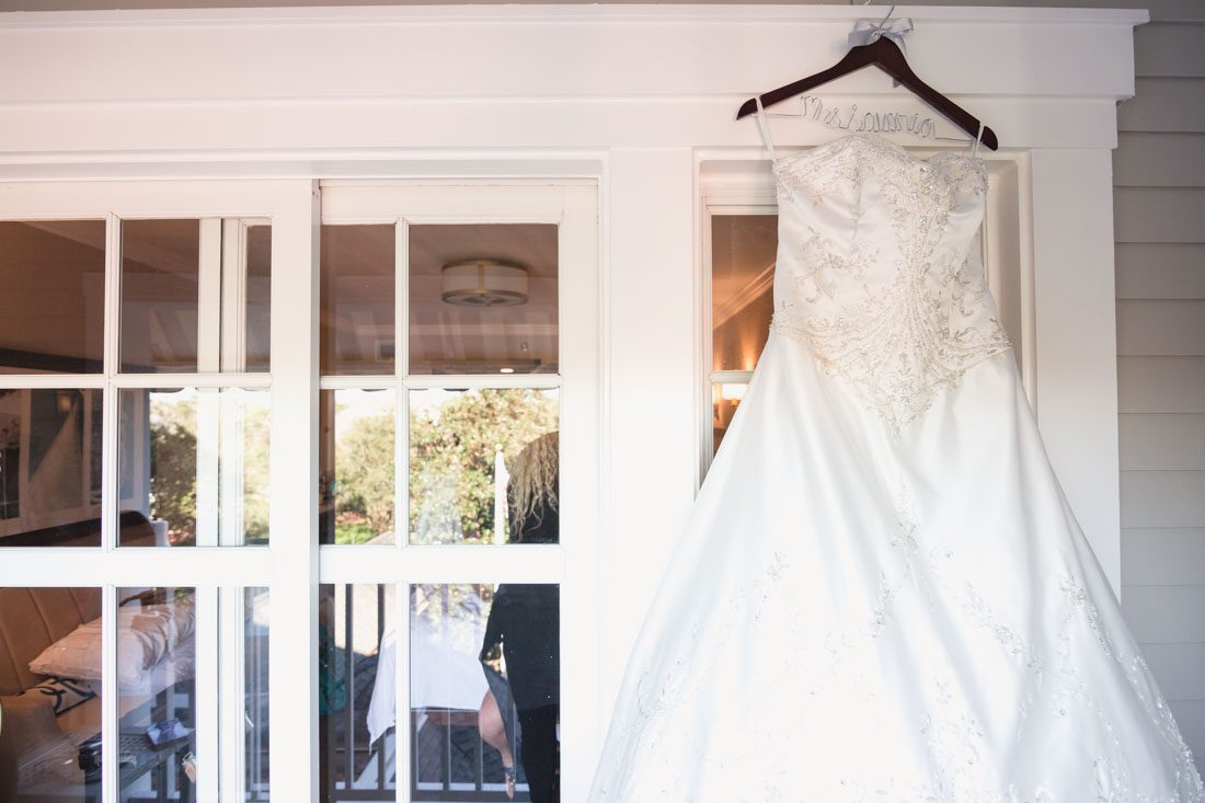 Detail shot of the brides dress for her Disney wedding day in Orlando, Florida with photography and videography by Captured by Elle