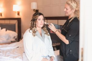Disney bride getting her hair and makeup done by Laura Reynolds Artistry for her destination wedding at Sea Breeze Point