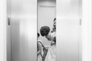 Orlando wedding photographer captures the moment the bride gets on the elevator for her Disney wedding day