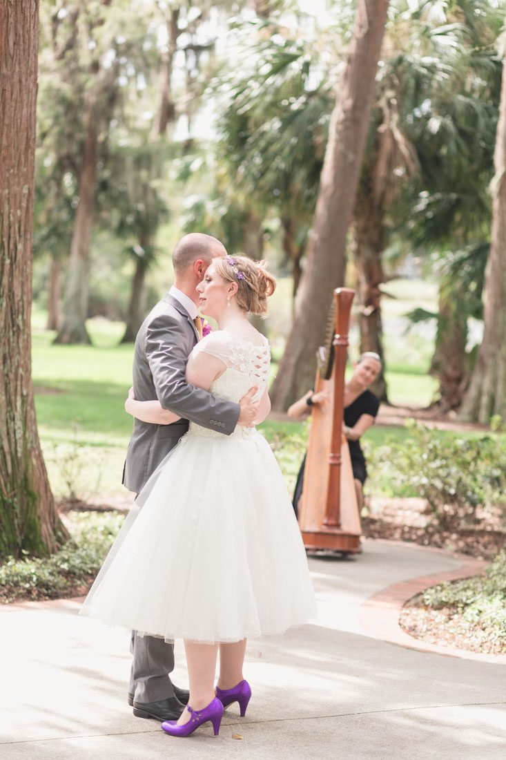 Couple shares their first dance in the park with a harpist after their elopement at Cypress Grove park captured by top Orlando photographer and videographer