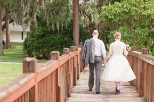 Romantic and candid photography at Cypress Grove Park after an intimate wedding ceremony by top Orlando wedding photographer