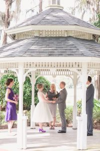 Orlando wedding photographer captures intimate wedding ceremony under a gazebo at Cypress Grove Estate House Park in Orlando, FL