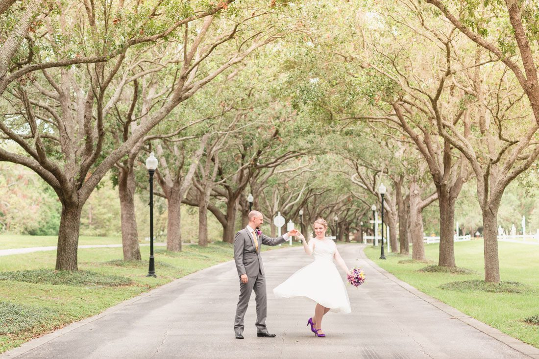 Bride and groom surrounded by gorgeous Cypress trees at this incredible park venue in Orlando, Florida during their intimate wedding day