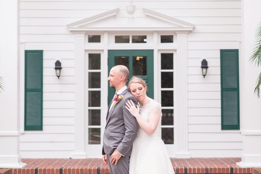 Romantic photo of the newlyweds in front of the historic estate house venue at Cypress Grove Park in Orlando