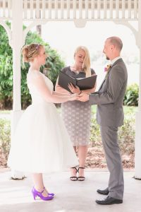 Couple exchanges rings during elopement at Cypress Grove in Orlando captured by top photographer and videographer