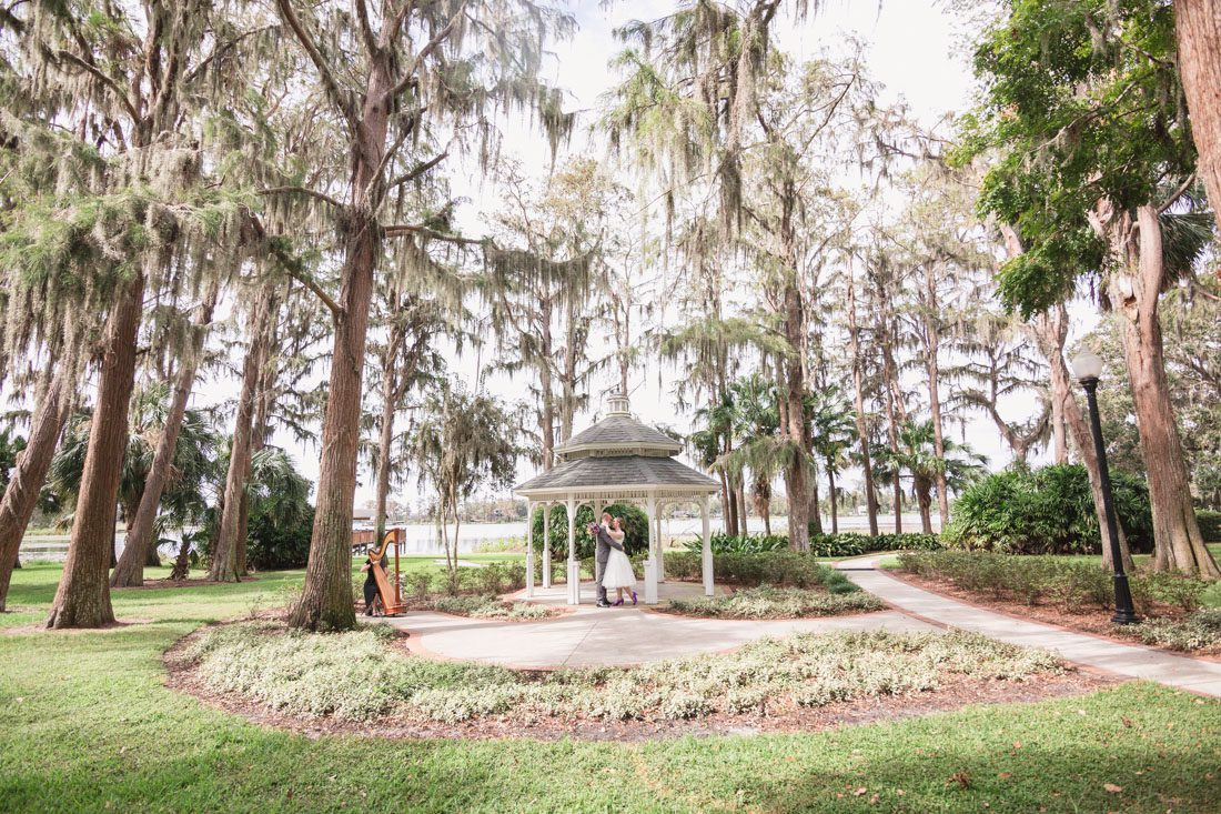 Orlando wedding photography and videography team capture romantic intimate wedding at a gazebo in Cypress Grove Park in Orlando