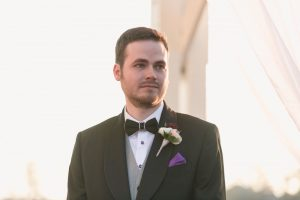 Grooms reaction to seeing his partner down the aisle at their outdoor wedding at Cypress Grove park in Orlando Florida