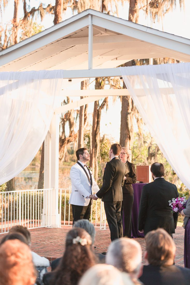 Gay wedding in Orlando at the Cypress Grove estate on the lake captured by top Orlando LGBT wedding photographer