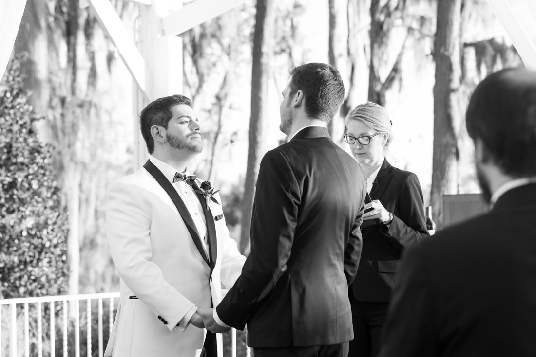 Sunset wedding at Cypress Grove estate house captured by top gay wedding photographers in Orlando