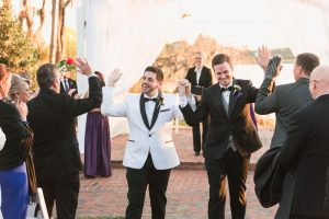Orlando gay wedding ceremony outdoors on the waterfront at Cypress Grove captured by wedding photographers in Orlando