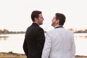 Gay wedding inspiration with grooms wearing black and white tuxes during their Orlando wedding day