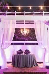 Purple violet lilac wedding decor at outdoor venue in Orlando captured by top Orlando wedding photographers