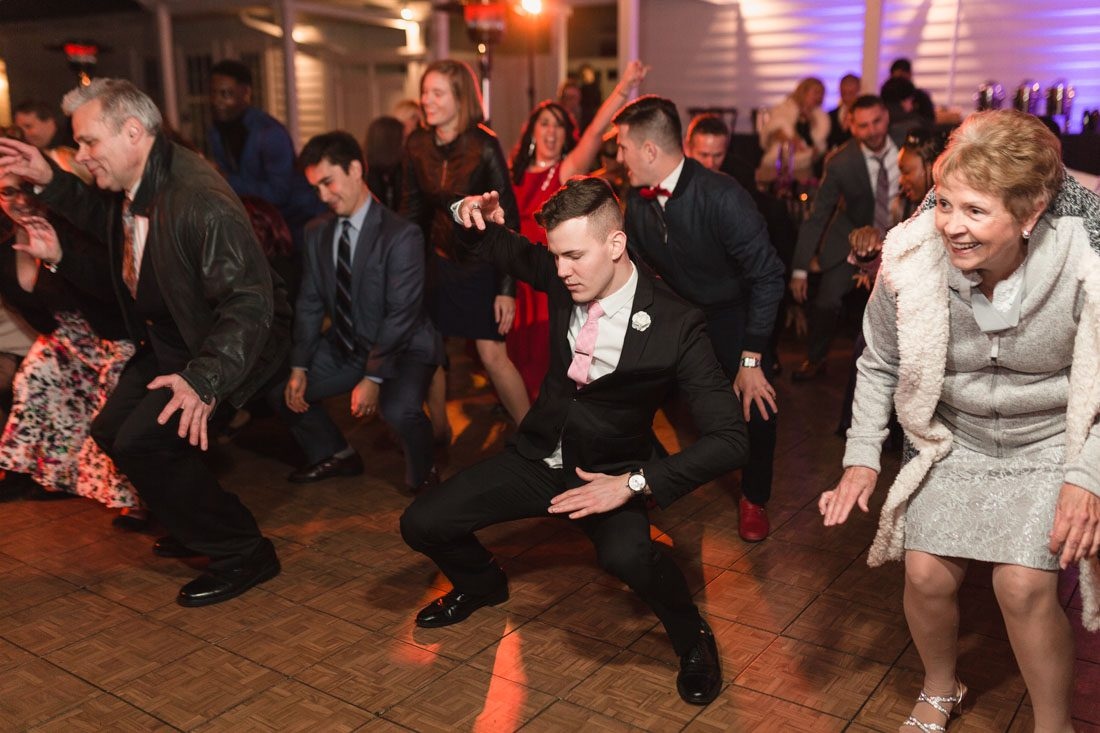 Orlando wedding photographer captures candid photos on the dance floor at a reception for a gay wedding in Orlando at Cypress Grove