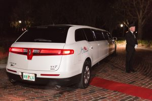 Photo of the limo at Cypress Grove estate for a sparkler exit with two grooms at a gay wedding in Orlando