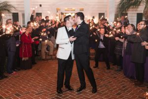 Grooms during their sparkler exit from their gay wedding at the Cypress Grove estate house by top same-sex wedding photographer in Orlando
