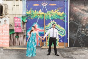 Orlando engagement photography with art murals around downtown by top Orlando wedding photographers