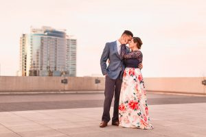Rooftop engagement photo taken in downtown Orlando at the Balcony by wedding photographer at sunset