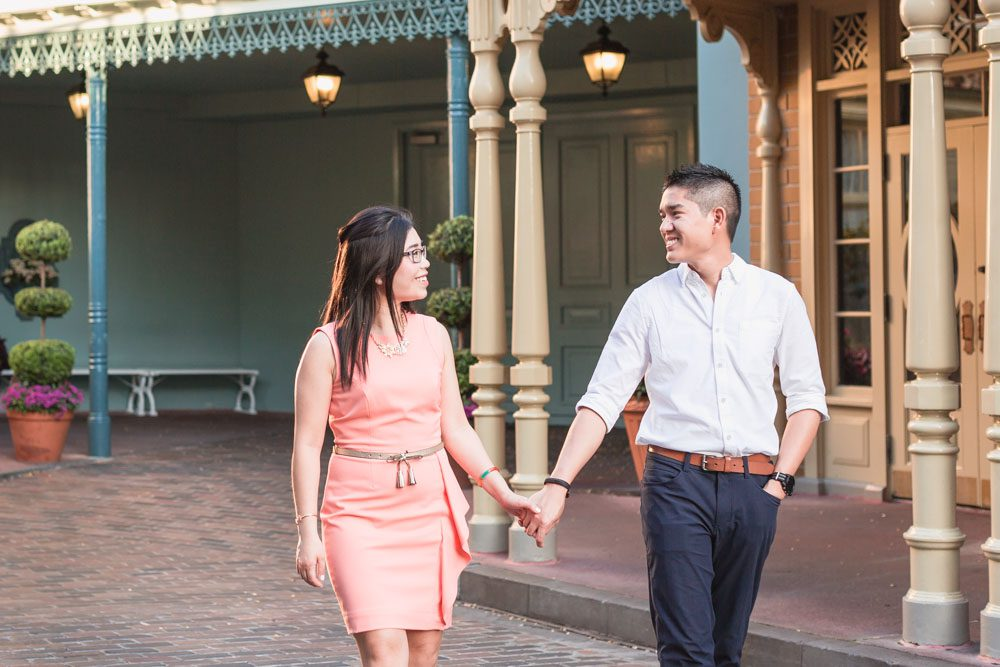 Orlando engagement photographer captures fun Disney photos at Magic Kingdom on Main Street