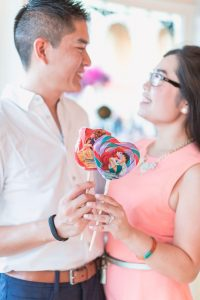 Fun engagement photo taken at Disney World candy shop by top Orlando wedding and engagement photographer