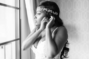 Black and white photo of the bride getting ready for her Disney wedding at the Four Seasons in Orlando