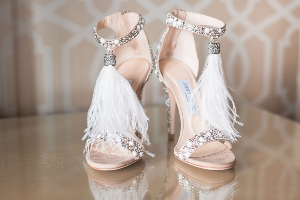 Bride's feather and glitter Jimmy Choo heels for her wedding at the Four Seasons in Orlando FL