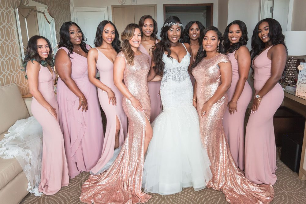 Bridesmaids and bride at the Four Seasons wearing blush pink and gold sequin dresses