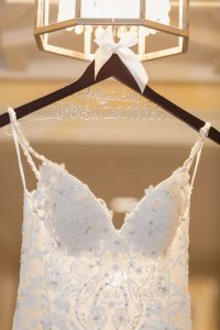 Bride's personalized dress hanger in the hallway of the Four Seasons resort for their Orlando wedding day
