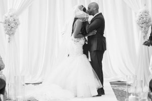 Newlyweds share their first kiss and husband and wife during their indoor wedding ceremony in Orlando